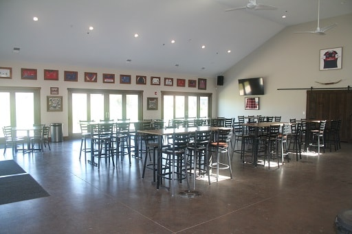 Wide view, spacious reception area - Tables and Chairs Inside Blaze Clubhouse