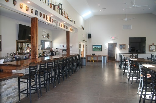Tables and Chairs - Side view near the bar inside Blaze Clubhouse
