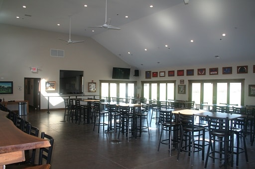 Inside Blaze Clubhouse - Spacious, Tables and Chairs